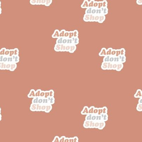 Adopt don't shop - animal shelter and pet adoption saying text design retro seventies style moody coral stone red