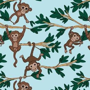 Curious little monkey friends in trees wild animals jungle safari design for kids blue green