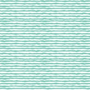Uneven light teal stripes