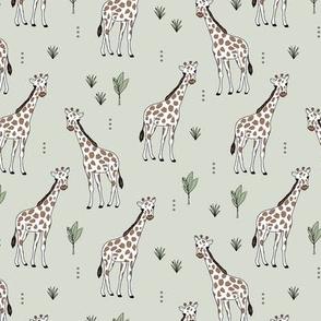 Little giraffe and leaves minimalist style illustration wild life green brown on mist green