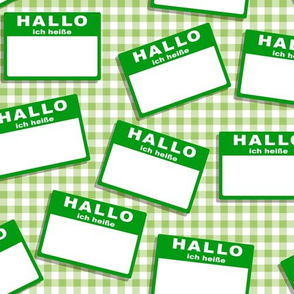 Scattered German 'hello my name is' nametags - green on gingham