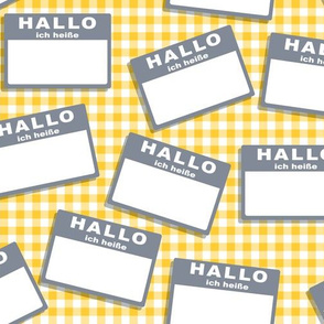 Scattered German 'hello my name is' nametags - grey on yellow gingham