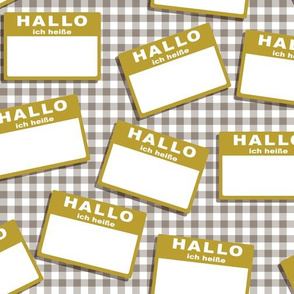 Scattered German 'hello my name is' nametags - mustard on grey gingham