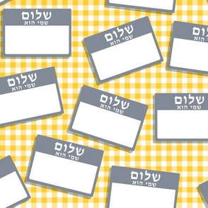 Scattered Hebrew 'hello my name is' nametags - grey on yellow gingham