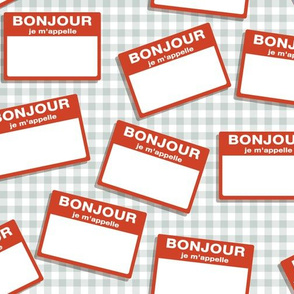 Scattered French 'hello my name is' nametags - red on grey gingham