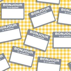 Scattered French 'hello my name is' nametags - grey on yellow gingham
