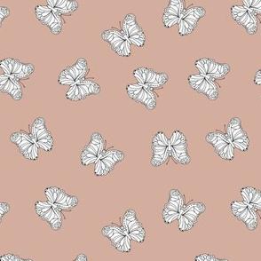 The minimalist boho butterfly nursery scandi textiles coral blush white