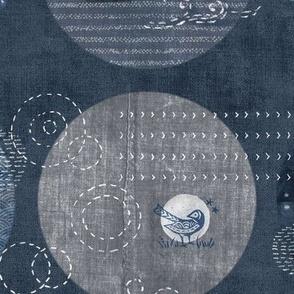 Sashiko Circles in Indigo Blue | Japanese stitch patterns on a dark blue linen patchwork, shibori linen, visible mending, block prints in navy blue and gray.
