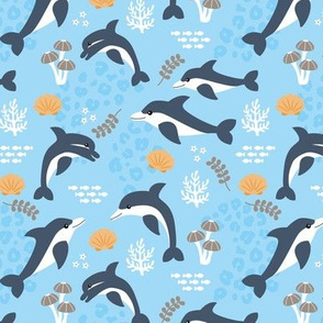 Under water world and sea life dolphins coral reef and fish blue orange