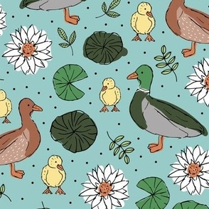 Little duck family romantic english garden with pond leaves and water lilies mint teal green
