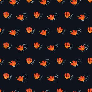 Orange cactus blossoms on black
