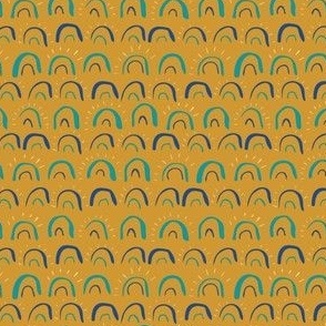 Painted sunshine and rainbows on gold