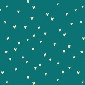 Delicates heart pattern on a teal background