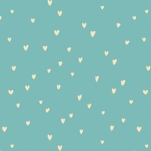 Delicates heart pattern on a light teal background