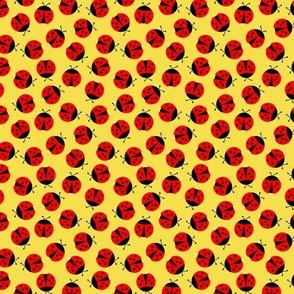 ladybugs on yellow medium