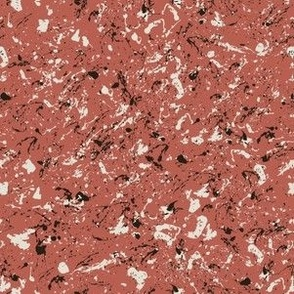Marbled paint splatter in coral red