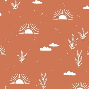 Sunrise morning sweet sun clouds and trees botanical boho garden fall burnt orange coral white