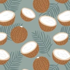 Coconut palm leaves garden tropical jungle fruit island vibes moody gray blue caramel
