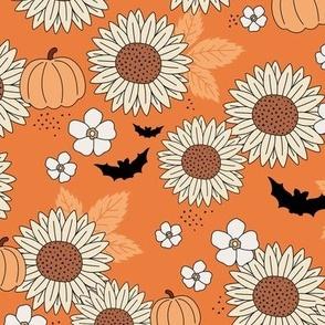 Sunflowers field and pumpkin patch boho garden fall blossom and bats halloween design orange caramel peach