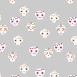 Boho dia de los muertos skulls with lush flowers and leaves Mexican halloween design pink white green on gray