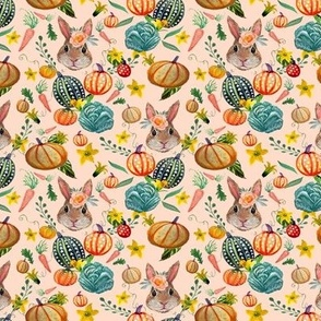 Rabbit and pumpkins harvest with cabbage and carrots on pink