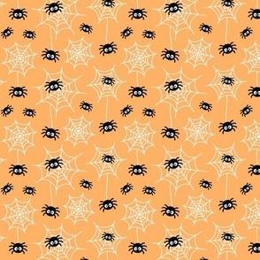 tiny spiders and webs pastel orange » halloween