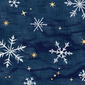 Shibori Snow and Stars on Dark Indigo (large scale)   Snowflakes and gold stars on arashi shibori linen pattern, block printed stars on navy blue, Christmas fabric, winter night sky.