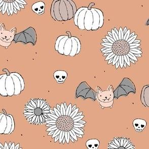 Sunflowers and pumpkins sweet halloween vintage style bats and skulls garden fall seventies orange coral gray
