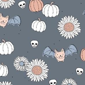 Sunflowers and pumpkins sweet halloween vintage style bats and skulls garden fall seventies orange on cool gray