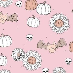Sunflowers and pumpkins sweet halloween vintage style bats and skulls garden fall seventies orange on baby pink blush