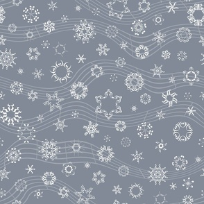 wind-blown musical snowflakes on grey