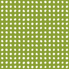 Painted polka dots on green