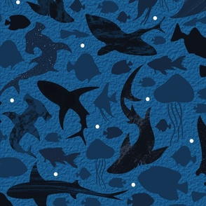 Fishes deep in the dark blue sea large