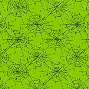 Spiderwebs on green