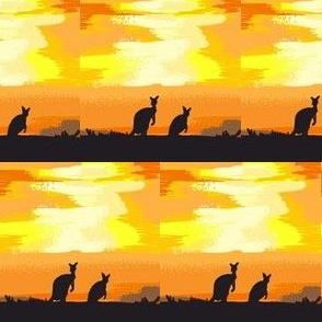 kangaroos crossing the desert at dusk