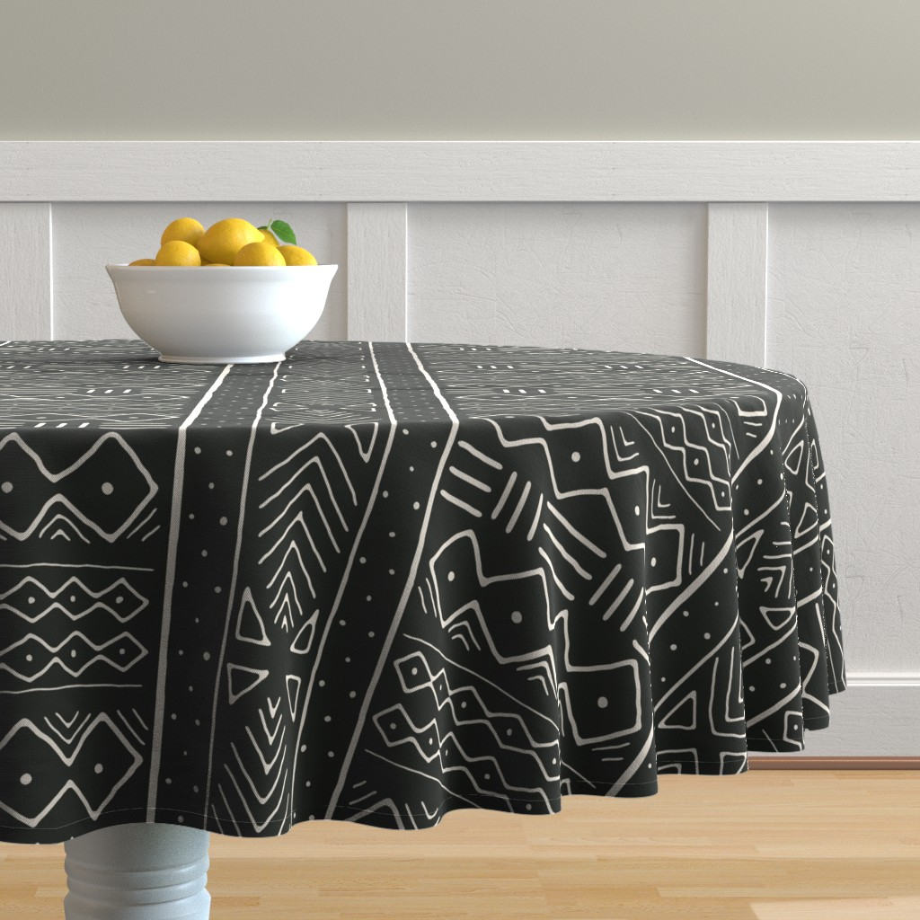 Malay Round Tablecloth featuring Mudcloth in bone on black by domesticate