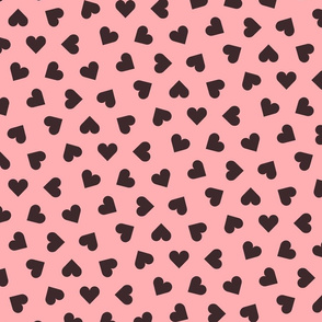 dark chocolate hearts on pink