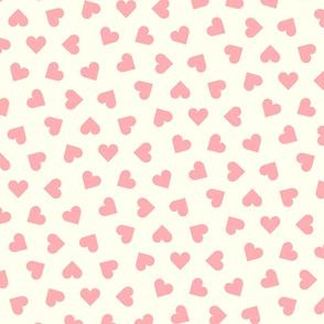 pink hearts on cream