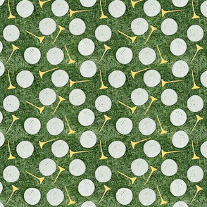 Golf Balls & Yellow Tees on the Green