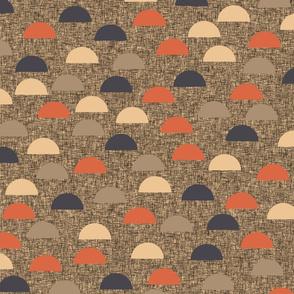 Half circles on brown linen