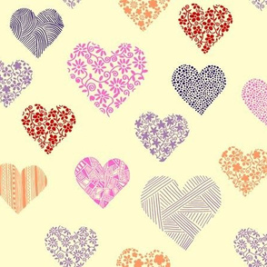 Random floral and patterned hearts on cream