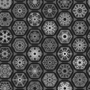 snowflake mini-ornaments on charcoal