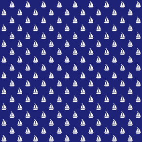 Small White Sailboats on Blue