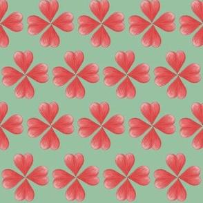 Watercolor Love heart flowers on green.
