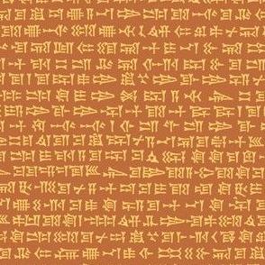 cuneiform in sunrise gold