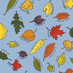 happy autumn leaves on blue