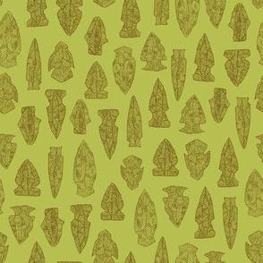 arrowheads in bronze on golden green