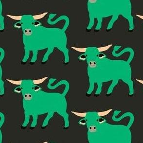 Green Taurus bull on deep green