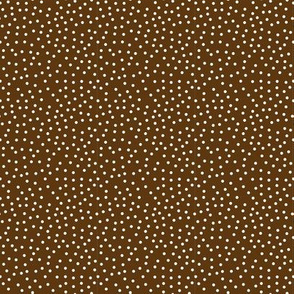 Tiny White Dots on Brown
