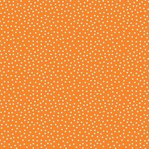 Tiny White Dots on Bright Orange